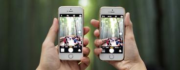 Hands holding smart phone