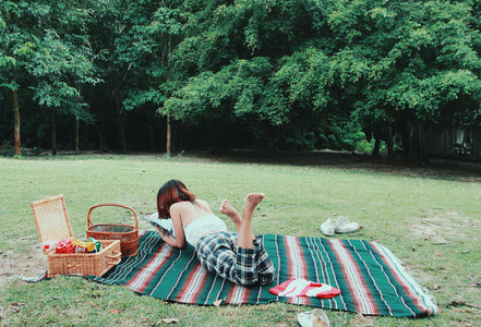 Young girl lying in park