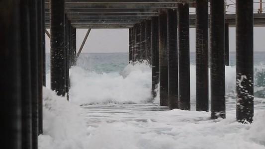 Coming waves beat on steel pier