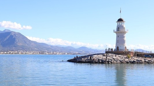 Sea lighthouse with mountains