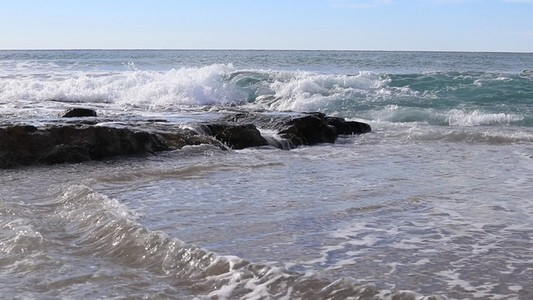 Sea waves on the rocky shore