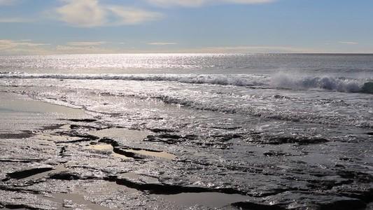 Calm splashing cliff waves